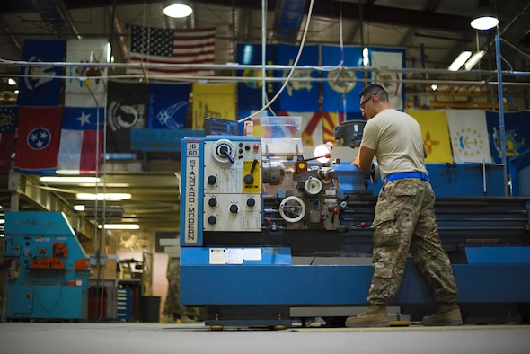 Senior Airman Elio Esqueda, 386th Expeditionary Maintenance Squadron aircraft metals technician, uses a lathe to create a 'Spline Insert Extractor,' May 16, 2018, at an undisclosed location in Southwest Asia. The tool was originally created by Tech. Sgt. Chance Cole and Staff Sgt. Hermann Nunez, 386th Air Expeditionary Aircraft Maintenance Squadron. (U.S. Air Force photo by Staff Sgt. Christopher Stoltz)
