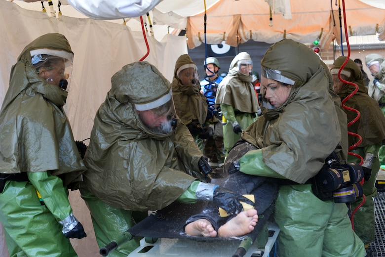 48th Medical Group Airmen decontaminate a patient with simulated injuries following a mass casualty scenario during a readiness exercise at Royal Air Force Lakenheath, England, June 5, 2018. Airmen from the 192nd Medical Group, Virginia Air National Guard, supported the exercise by participating as role players during multiple scenarios. (U.S. Air Force photo by Master Sgt. Eric Burks)