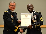 DLA Troop Support Commander Army Brig. Gen. Mark Simerly (left) poses with Army Sgt. 1st Class Troy Pringle after presenting his certificate of retirement June 1 in Philadelphia. Pringle was joined by friends and family who honored his retirement after 23 years of service in the Army.