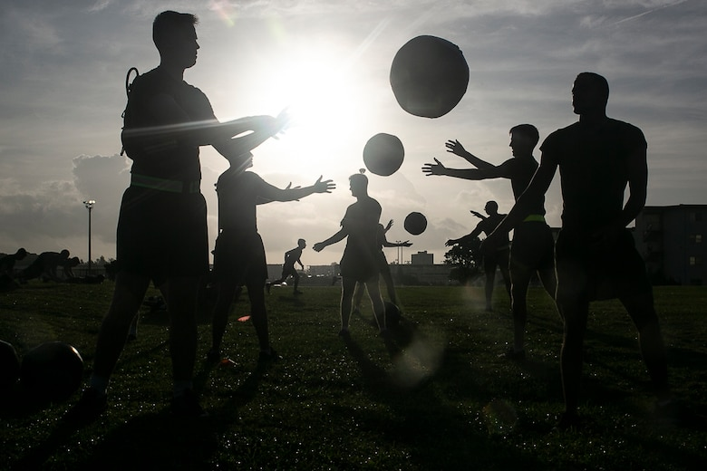 Noncommissioned officers with the 31st Marine Expeditionary Unit toss medicine balls during a Force Fitness Instructor led High Intensity Tactical Training session at Camp Hansen, Okinawa, Japan, June 8, 2018. The 31st MEU is adopting an NCO-led FFI program to improve overall physical fitness while reducing injury and building unit morale. The 31st MEU, the Marine Corps' only continuously forward-deployed MEU, provides a flexible force ready to perform a wide-range of military operations.