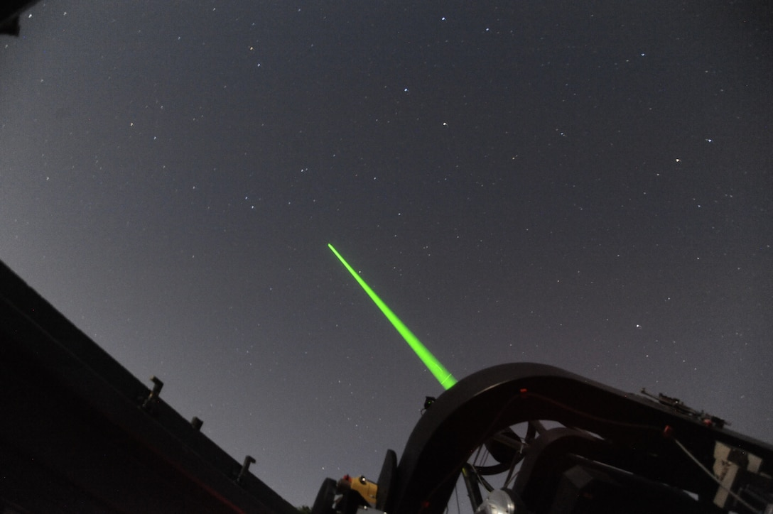 The Turbulence and Aerosol Research Dynamic Interrogation System, or TARDIS, laser is fired into the night sky above the John Bryan State Park observatory May 24, 2018. Scientists from the Electro-Optical Space Situational Awareness Team at the Air Force Research Laboratory Sensors Directorate then analyze data returned by backscattered light to study turbulence in the atmosphere, thereby allowing for a better capability of imaging objects in space.  (U.S. Air Force photo/Bryan Ripple)