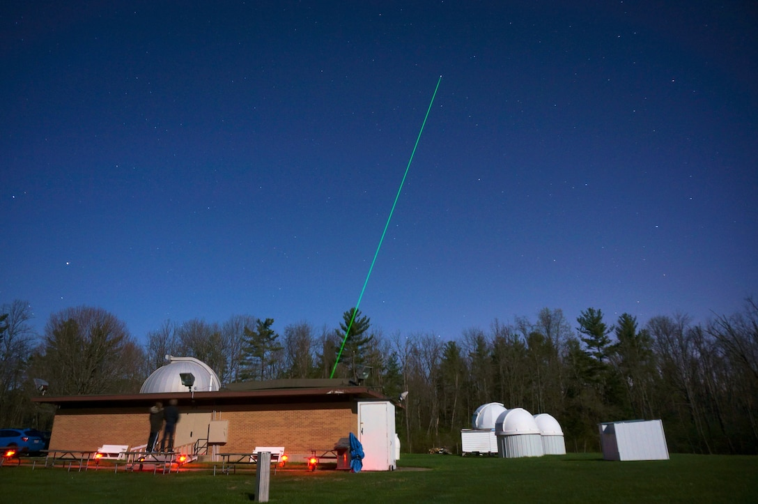 The Turbulence and Aerosol Research Dynamic Interrogation System, or TARDIS, laser is fired into the night sky above the John Bryan State Park observatory April 29, 2018. Scientists from the Electro-Optical Space Situational Awareness Team at the Air Force Research Laboratory Sensors Directorate then analyze data returned by reflected light to study turbulence in the atmosphere, thereby allowing for a better capability of imaging objects in space. (U.S. Air Force photo/Dan LeMaster)
