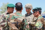 Master Sgt. Lou Spinazze, senior enlisted leader for the Police Advising Team for Train, Advise and Assist Command-South, talks with Afghan senior enlisted leaders, May 25, 2018, during a meeting at the Regional Military Training Center-Kandahar.