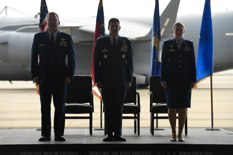 U.S. Air Force Brig. Gen. Thomas Kennett (left), Assistant Adjutant General for Air, North Carolina National Guard (NCANG), Col. Michael Gerock (center), commander of the 145th Airlift Wing (AW), and Col. Bryony Terrell (right), stand at attention prior to the passing of the guide-on which signifies the official change of command held at the NCANG Base, Charlotte Douglas International Airport, June 9, 2018. Gerock will relinquish command to Col. Bryony Terrell who will be the the first female commander for the 145th AW.