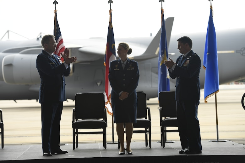 U.S. Air Force Brig. Gen. Thomas Kennett (left), Assistant Adjutant General for Air, North Carolina National Guard (NCANG), and Col. Michael Gerock (right), give a round of applause to Col. Bryony Terrell, Commander of the 145th Airlift Wing (AW), during a Change of Command Ceremony held at the NCANG Base, Charlotte Douglas International Airport, June 9, 2018. Terrell is the first female commander for the 145th AW and is a third generation Airmen. Terrell's grandfather served in the Army Air Corps, and her father was a rescue pilot in Vietnam.