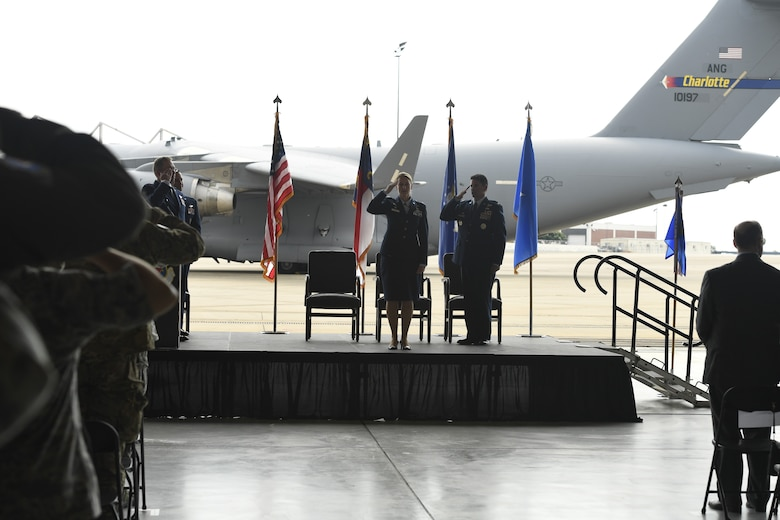 U.S. Air Force Col. Bryony Terrell, commander of the 145th Airlift Wing (AW), receives a first salute from members of the unit during a Change of Command Ceremony held at the North Carolina Air National Guard Base, Charlotte Douglas International Airport, June 9, 2018. Terrell is the first female commander for the 145th AW and is a third generation Airmen. Terrell's grandfather served in the Army Air Corps, and her father was a rescue pilot in Vietnam.