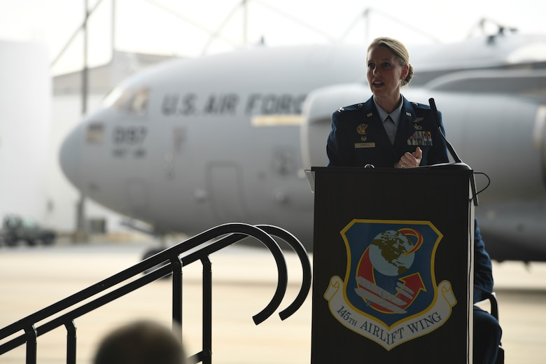 U.S. Air Force Col. Bryony Terrell, commander of the 145th Airlift Wing (AW), addresses members of the unit during a Change of Command Ceremony held at the North Carolina Air National Guard Base, Charlotte Douglas International Airport, June 9, 2018. Terrell is the first female commander for the 145th AW and is a third generation Airmen. Terrell's grandfather served in the Army Air Corps, and her father was a rescue pilot in Vietnam.