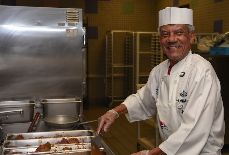 Septus Wallace, a 56th Force Support Squadron food services work leader, smiles as he prepares stuffed peppers for lunch at the Hensman Dining Facility June 8, 2018 at Luke Air Force Base, Ariz.