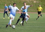 FORT BRAGG, N.C. – Air Force Capt. Eric Wilson, stationed at Schriever Air Force Base, Colo., leads an offensive attack against Navy defense during the 2018 Armed Forces Men's Soccer Championship. The championship was held at Fort Bragg, N.C. from 2-10 June, and featured Service members from the Army, Marine Corps, Navy (including Coast Guard) and Air Force. (U.S. Navy photo by Mass Communication Specialist 2nd Class John Benson/Released)