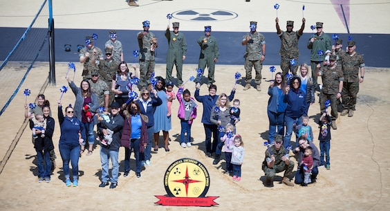 During the event there were activities for the whole family, food and an opportunity to create a human ribbon to recognize the Purple Ribbon Campaign, supporting Domestic Violence Awareness month. (Official USMC Photos by Sgt. Ryan M. Heintzelman)