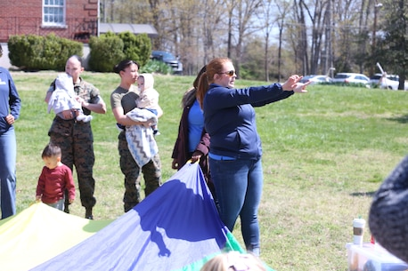"Chemical Biological Incident Response Force family readiness team, with the assistance of Marine Corps Community Services Henderson Hall, hosted a ""Healthy Relationships"" family day event aboard Naval Support Facility Indian Head, Md., April 17, 2018. During the event there were activities for the whole family, food and an opportunity to create a human ribbon to recognize the Purple Ribbon Campaign, supporting Domestic Violence Awareness month. (Official USMC Photos by Staff Sgt. Santiago G. Colon Jr.)"
