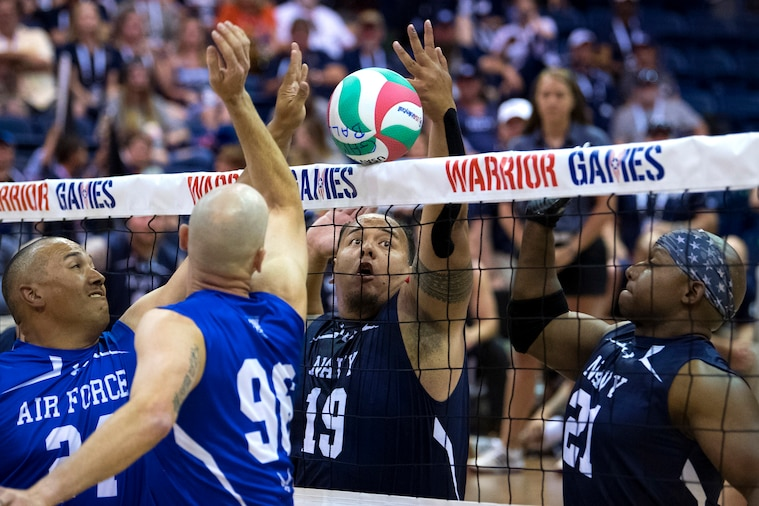 Wounded warrior athletes compete in sitting volleyball during the 2018 Department of Defense Warrior Games at the U.S. Air Force Academy in Colorado Springs, Colo., June 6, 2018. DoD photos by multiple photographers