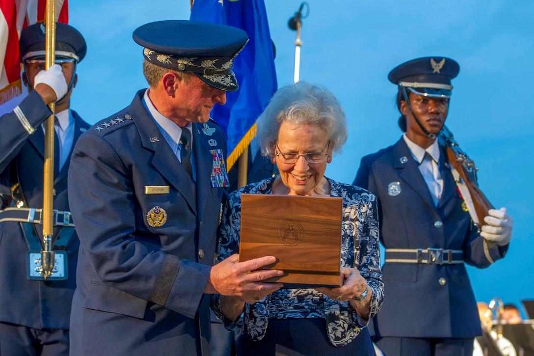Air Force Chief of Staff Gen. David L. Golden presents a set of Brigadier General stars to Mrs. Doris Day.