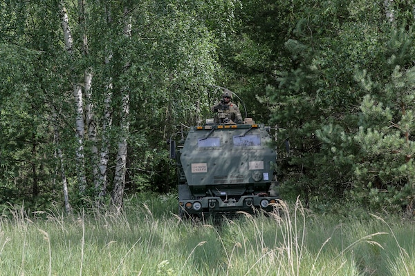 A Soldier assigned to 1st Battalion, 623rd Field Artillery Regiment, Kentucky Army National Guard, waits in his High Mobility Artillery Rocket System (HIMARS) for a fire mission  during the Saber Strike 18 exercise in Kazlu Ruda, Lithuania, on June 10, 2018. Crews of the Kentucky Army National Guard rehearsed no-notice dry-fire drills repeatedly to ensure mastery of their weapons system.