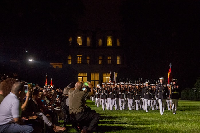Marines with Alpha Company, Marine Barracks Washington D.C., march across the parade deck during the Friday Evening Parade at the Barracks, June 8, 2018.