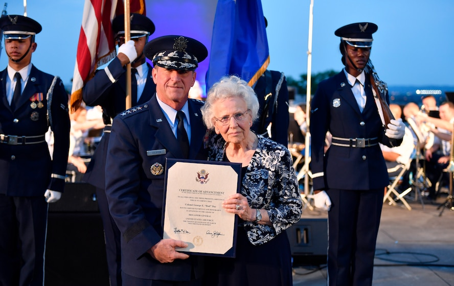 "Chief of Staff of the Air Force Gen. David L. Goldfein and Mrs. Doris Day, widow of retired Col. George E. ""Bud"" Day, accepts the certificate of advancement on behalf of her husband during the 2018 Heritage to Horizons summer concert in Arlington, Va., June 8, 2018.  (U.S. Air Force photo by Wayne A. Clark)"