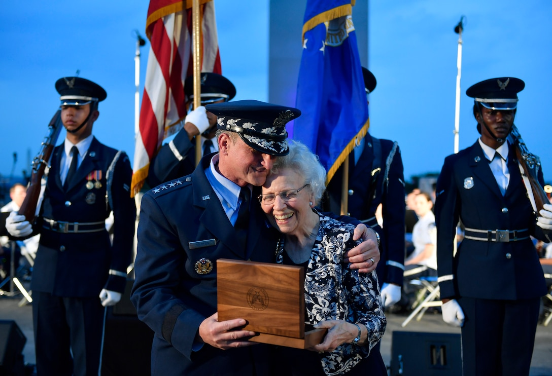 "Chief of Staff of the Air Force Gen. David L. Goldfein presents Mrs. Doris Day the brigadier general rank of her deceased husband, retired Col. George E. ""Bud"" Day,  during the 2018 Heritage to Horizons summer concert in Arlington, Va., June 8, 2018. The stars were originally Goldfein's when he was a brigadier general. (U.S. Air Force photo by Wayne A. Clark)"
