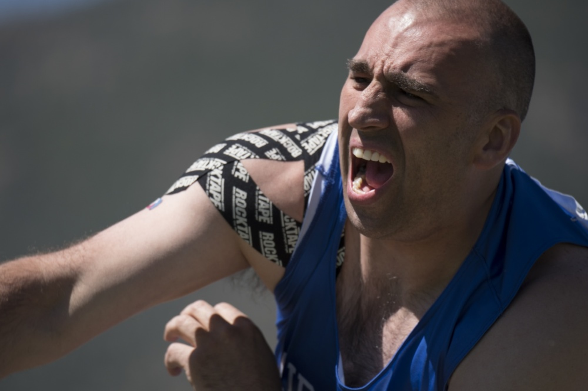 Master Sgt. Michael Christiansen, Department of Defense Warrior Games athlete on Team Air Force, competes in the seated shot put event at the Games in Colorado Springs, Colo., June 2, 2018. Adaptive sports, like those practiced at the warrior Games, provide opportunities for athletes to heal and to regain confidence and purpose; the Games are a way to celebrate the athlete's efforts and commitment to healing. (U.S. Air Force photo by Senior Airman Dennis Hoffman)