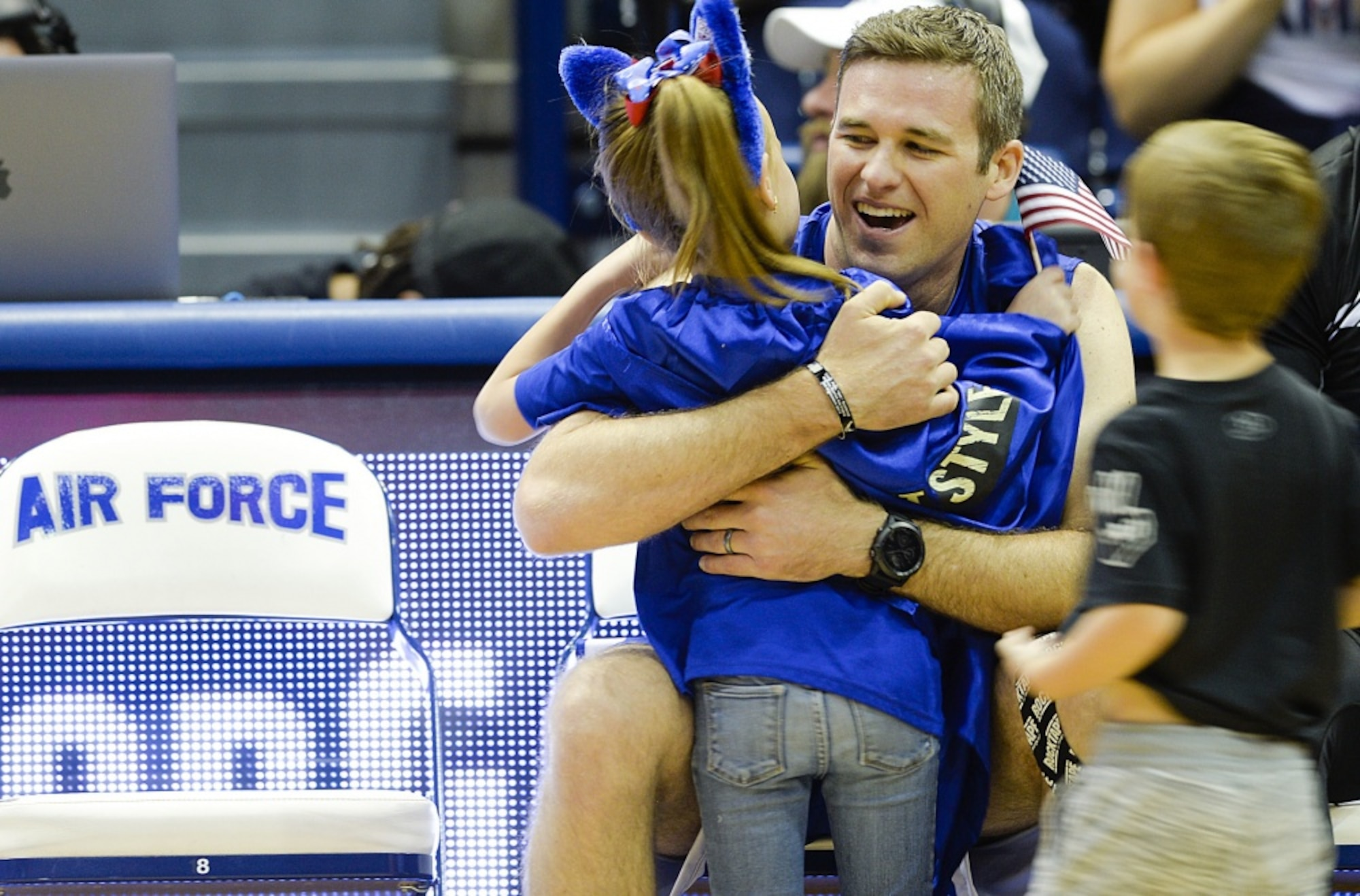 Team Air Force athlete Capt. Hunter Barnhill receives a hug from his children after winning silver in the rowing competition during the Department of Defense Warrior Games at the U.S. Air Force Academy, Colorado Springs, Colo., June 9, 2018. Approximately 300 wounded, ill and injured service members and veterans participated in the Games. Competing athletes represented the U.S. Air Force, Army, Marine Corps, Navy, and Special Operations Command, as well as the U.K. Armed Forces, Australian Defence Force and Canadian Armed Forces. (U.S. Air Force photo by Tech Sgt. Anthony Nelson Jr.)