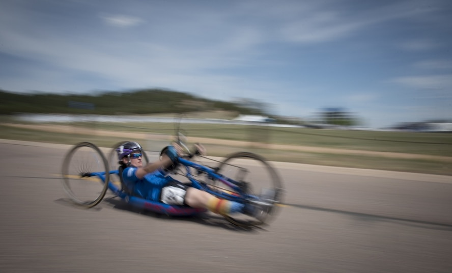 Master Sgt. Lisa Goad, Department of Defense Warrior Games athlete and Team Air Force member, competes in the cycling competition at the U.S. Air Force Academy, Colorado Springs, Colo., June 6, 2018. Competing in the Games are service members and veterans with upper-body and lower-body limitations, spinal cord injuries, traumatic brain injuries, visual impairments, serious illnesses, and post-traumatic stress. Each of the Air Force's 39 participating athletes will compete in one or more of 11 sports including archery, cycling, shooting, sitting volleyball, swimming, track, field, wheelchair basketball, indoor rowing, powerlifting, and time-trial cycling. (U.S. Air Force photo by Senior Airman Dennis Hoffman)