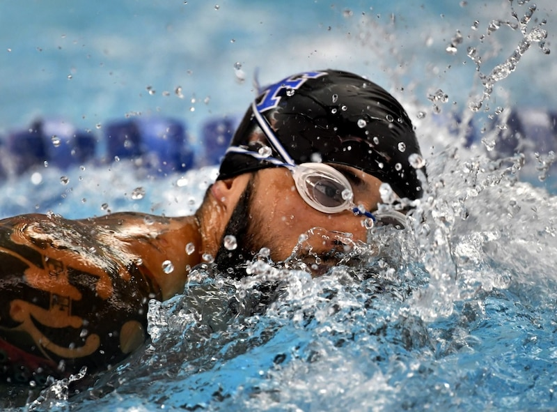 Team Air Force member Rafael Morfinenciso competes in the Department of Defense Warrior Games swimming competition at the U.S. Air Force Academy, Colorado Springs, Colo., June 7, 2018. There were 39 athletes representing Team Air Force at the Games, competing against wounded, ill and injured service members and veterans representing the U.S. Army, Marine Corps, Navy, and Special Operations Command, as well as athletes from the U.K. Armed Forces, Australian Defence Force and Canadian Armed Forces (U.S. Air Force photo by Staff Sgt. Rusty Frank)