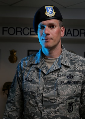 Master Sgt. Matthew A. Smith, the standards and evaluations program manager assigned to the 157th Security Forces Squadron,  poses for a portrait on May 30, 2018 at Pease Air National Guard Base, N.H. In addition to his full-time role, Smith is also responsible for educating base personnel about how to respond in the event of an active shooter or terror attack. (N.H. Air National Guard photo by Staff Sgt. Kayla White)