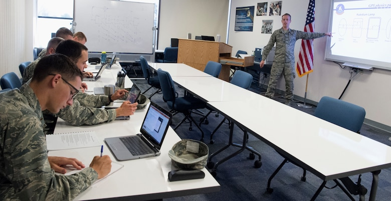 First Lt. Dillon Hagerty, staff instructor with the 50th OSS teaches students at Schriever Air Force Base, Colorado, June 6, 2018. The 50th OSS instructors provide the foundational and advanced knowledge necessary for students to become successful space operators. (U.S. Air Force photo by Senior Airman Arielle Vasquez)