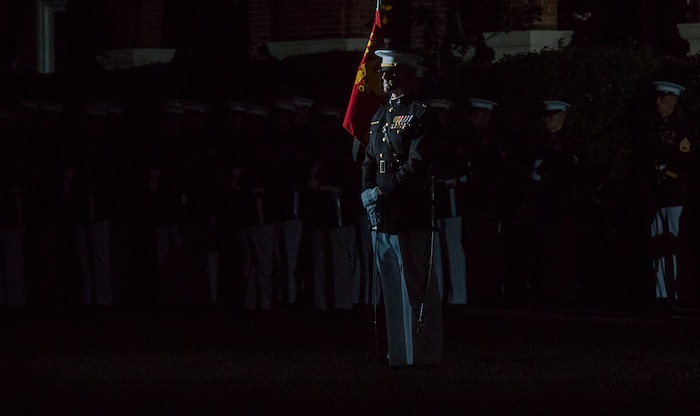 Captain Billy Grissom, company commander, Alpha Company, Marine Barracks Washington D.C., stands at a ceremonial position during the Friday Evening Parade at the Barracks, June 8, 2018. The hosting official for the parade was U.S. Marine Corps Lt. Gen. Frank McKenzie, director, Joint Staff, and the guests of honor were U.S. Army Lt. Gen. Joseph Anderson, deputy chief of staff for the Army; U.S. Marine Corps Lt. Gen. Brian Beaudreault, deputy commandant, plans, policies and operation; U.S. Navy Vice Adm. Andrew Lewis, deputy chief of operations for operations, plans and strategy; and U.S. Air Force Lt. Gen. Mark C. Nowland, deputy chief of staff for operations.