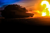 USTKA, Poland (June 8, 2018) A U.S. Marine Corps M1A1 Abrams tank attached to Tank Platoon, Fox Company, Battalion Landing Team, 2nd Battalion, 6th Marine Regiment, 26th Marine Expeditionary Unit, engage targets at night during live-fire training as part of exercise Baltic Operations (BALTOPS) 2018 at Ustka, Poland, June 8.