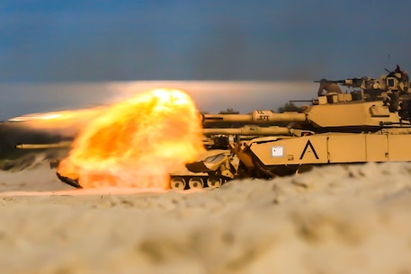 USTKA, Poland (June 9, 2018) A U.S. Marine Corps M1A1 Abrams tank attached to Tank Platoon, Fox Company, Battalion Landing Team, 2nd Battalion, 6th Marine Regiment, 26th Marine Expeditionary Unit, engage targets at night during live-fire training as part of exercise Baltic Operations (BALTOPS) 2018 at Ustka, Poland, June 9.