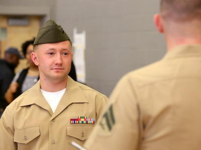 Marines and Sailors with Chemical Biological Incident Response Force, U.S. Marine Corps Forces Command, volunteered their time to conduct a JROTC uniform inspection at St. Charles High School in Waldorf, Md., April 18, 2018. During the inspection the Marines and sailors looked over the students' uniforms, tested their military knowledge and shared their expertise with the high school students. (Official USMC Photos by Staff Sgt. Santiago G. Colon Jr.)