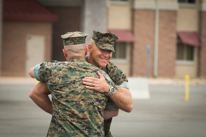 U.S. Marine Corps Lt. Col. William E. O'Brien, left, the outgoing commanding general of 3rd Assault Amphibian Battalion (AABN), 1st Marine Division, congratulates Lt. Col. Keith C. Brenize, the oncoming commanding general of 3rd AABN during a change of command ceremony at Marine Corps Base Camp Pendleton, Calif., June 1, 2018. The ceremony was held in honor of O'Brien, who relinquished his post as 3rd AABN commanding general to Brenize.
