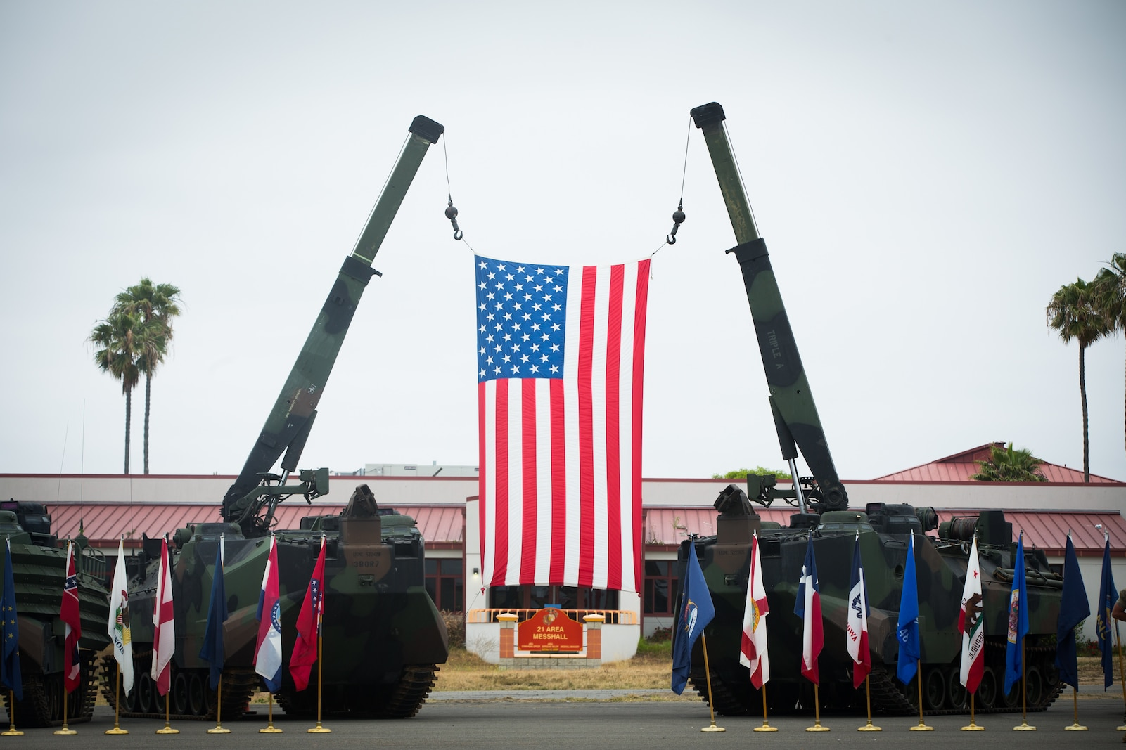 A U.S. flag hangs above the parade deck during a change of command ceremony at Marine Corps Base Camp Pendleton, Calif., June 1, 2018. The ceremony was held in honor of Lt. Col. William E. O'Brien, who relinquished his post as 3rd Assault Amphibian Battalion commanding general to Lt. Col. Keith C. Brenize.