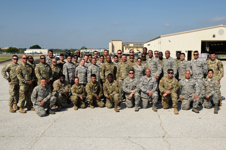 U.S. Air Force Reserves Command Chief Master Sgt. Ericka E. Kelly and Fourth Air Force Command Chief Master Sgt. Timothy C. White Jr. pose with members of the 74th Aerial Port Squadron and 61st Quartermaster Battalion at the Cargo Load Training facility June 2, 2018, at Joint Base San Antonio-Lackland, Texas. The command chiefs visited with members of the 433rd Airlift Wing during their visit in the area. (U.S. Air Force photo by Staff Sgt. Lauren M. Snyder)