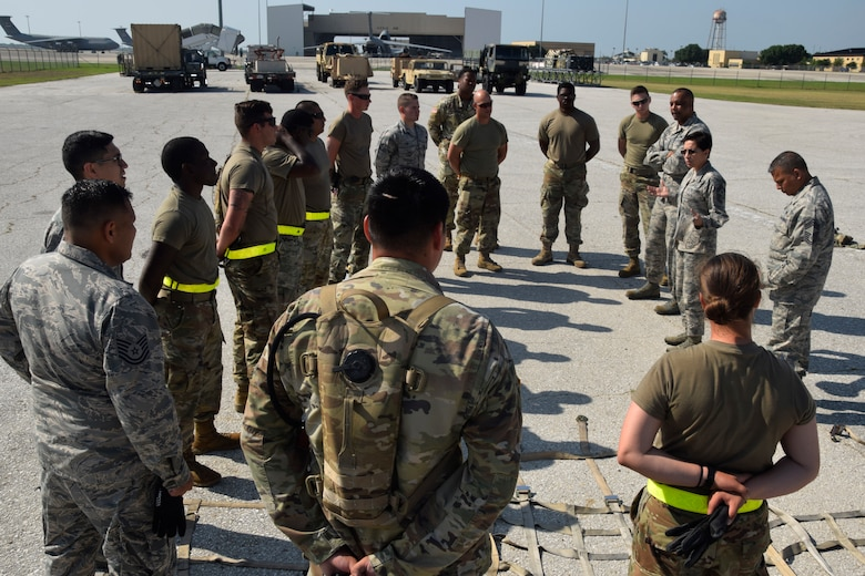 United States Air Force Reserve Command Chief Master Sgt. Ericka E. Kelly and Fourth Air Force Command Chief Master Sgt. Timothy C. White Jr. visit with members of the 74th Aerial Port Squadron and 61st Quartermaster Battalion at the Cargo Load Training facility June 2, 2018, at Joint Base San Antonio-Lackland, Texas. The aerial port squadron trains members to correctly load pallets to ensure aircraft can be loaded safely and efficiently. (U.S. Air Force photo by Staff Sgt. Lauren M. Snyder)