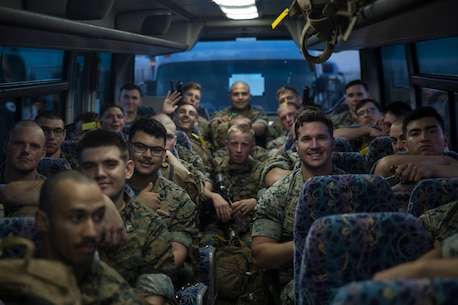 Marines with Battalion Landing Team, 2nd Battalion, 5th Marines, load onto busses headed to Camp Hansen, Okinawa, Japan, May 18, 2018.