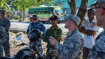 U.S. Air Force Master Sgt. Damon Weigl, the Pacific Angel 18-1 engineer team lead, explains what his team can expect in the next couple weeks during a site visit in Suai, Timor-Leste, June 7, 2018.