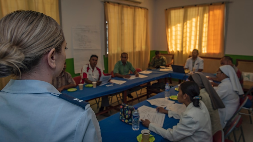 U.S. Air Force Capt. Elizabeth Persico, 35th Medical Operations Squadron health services provider, Misawa Air Base, Japan, talks with Timorese medical providers during a non-communicable diseases class and subject matter expert exchange during Pacific Angel 18-1 in Suai, Timor-Leste, June 8, 2018.