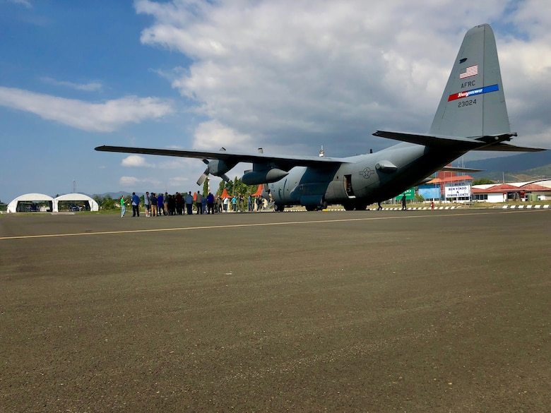 A 910th Air Wing C-130H Hercules from Youngstown, Ohio, flying more than 40 U.S. service members, equipment and supplies from Anderson Air Force Base, Guam, to Suai, Timor-Leste for Pacific Angel 18-1, sits on the flight line at Dili International Airport, June 6, 2018.