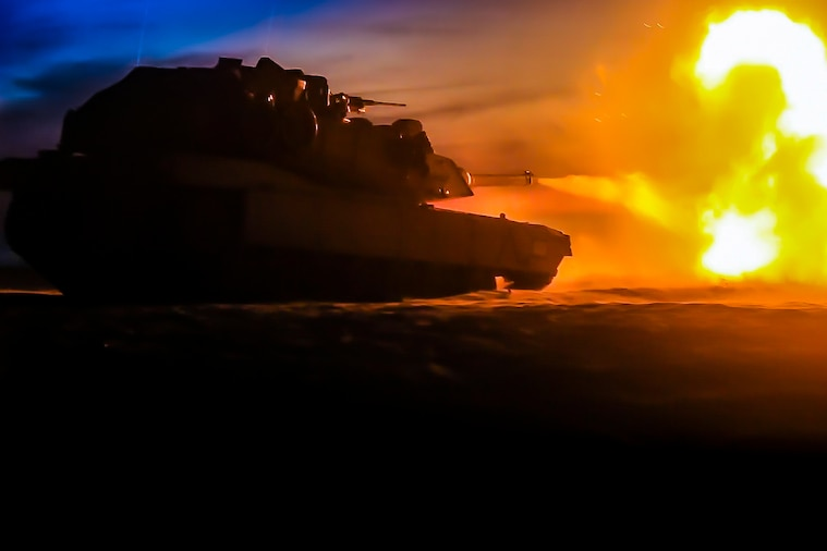 A tank fires at a target.
