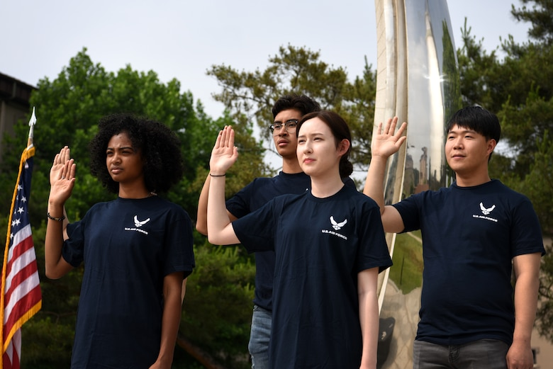 Five U.S. Air Force recruits participate in a swearing-in ceremony at Osan Air Base, Republic of Korea, June 8, 2018. The oath of enlistment used in a swearing-in ceremony is a military oath made on the occasion of joining or reenlisting in the United States armed forces. (U.S. Air Force photo by Senior Airman Kelsey Tucker)