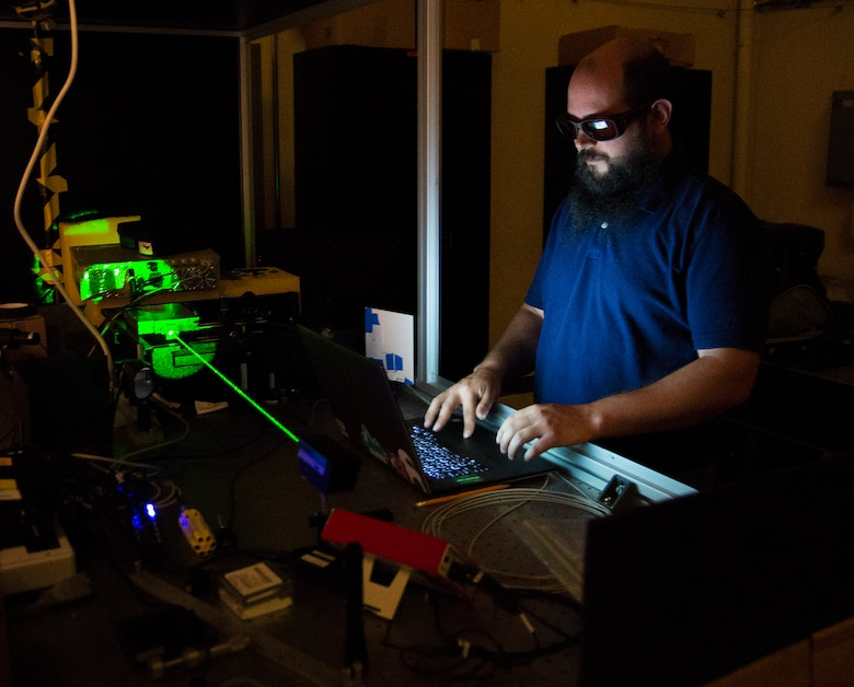 Steve Zuraski, an optical engineer with the Air Force Research Laboratory, works with the Turbulence and Aerosol Research Dynamic Interrogation System, or TARDIS laser in an Air Force Institute of Technology lab at Wright-Patterson Air Force Base, Ohio, June 21, 2017. Zuraski is an AFIT student earning an advanced degree in engineering physics. (U.S. Air Force photo/R.J. Oriez)