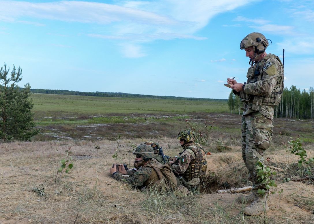 U.S. Air Force Senior Master Sgt. Perry Jackson, right, 122nd Air Support Operations Squadron superintendent, takes notes as an observer controller in Adazi, Latvia on June 7, 2018. Observer controllers help control scenarios for other controllers to work through during exercises and assist the Range Control Officer with safety. (U.S. Air Force photo by Staff Sgt. Jimmie D. Pike)