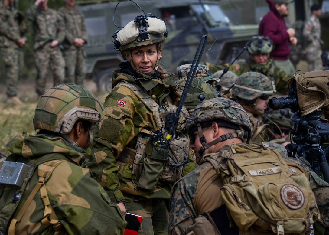 A Norwegian Joint Terminal Attack Controller discusses operations with U.S. Forces during Saber Strike 18 in Adazi, Latvia, June 5, 2018. Nineteen nations attended and participated in the exercise to build on each nations capabilities and improve partnership capacity. (U.S. Air Force photo by Staff Sgt. Jimmie D. Pike)