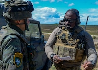 U.S. Air Force Tech. Sgt. Louis Awua, 122nd Air Support Operations Squadron Joint Terminal Attack Controller instructor, explains procedures for calling in close air support to OF-1 Ricardo Cobos, Spanish Forces JTAC, during Saber Strike 18 in Adazi, Latvia, June 5, 2018. During Saber Strike 18, approximately 18,000 members from 19 countries worked together to build on interoperability to improve air, land, and sea capabilities. (U.S. Air Force photo by Staff Sgt. Jimmie D. Pike)