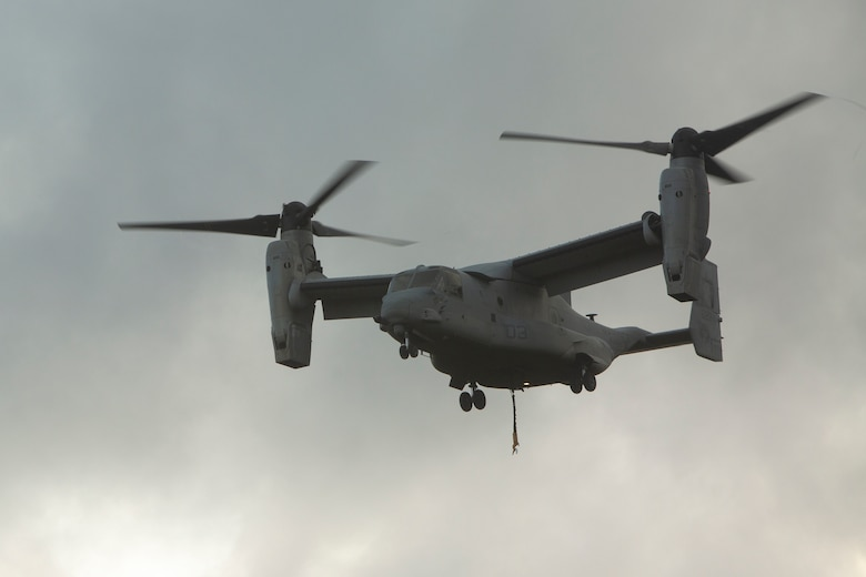 An MV-22 Osprey prepares to land during external lift training at Landing Zone Dodo, Camp Hansen, Okinawa, Japan, June 6, 2018. Landing support specialist Marines with Air Delivery Platoon, 3rd Transportation Support Battalion, 3rd Marine Logistics Group, conducted this training to refine their helicopter support skills. The Osprey is a heavy-lift helicopter capable of transporting 15,000 pounds of external cargo. (U.S. Marine Corps photo by Lance Cpl. Zackary M. Walker)