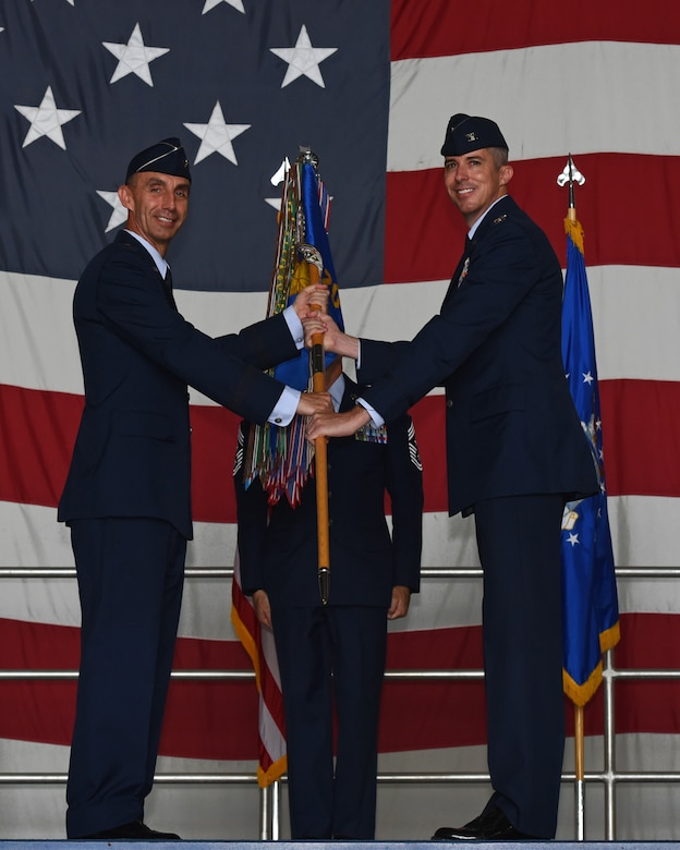 U.S. Air Force Maj. Gen. Scott J. Zobrist, 9th Air Force commander, left, gives the 20th Fighter Wing (FW) guidon to Col. Derek O'Malley, 20th FW commander, during a change of command ceremony at Shaw Air Force Base, S.C., June, 8, 2018.