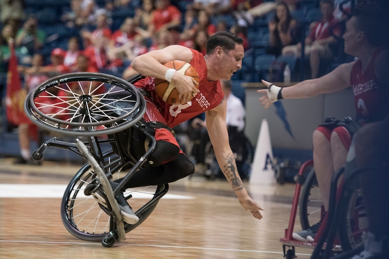 Service members compete in final wheelchair basketball events during the 2018 Department of Defense Warrior Games at the U.S. Air Force Academy in Colorado Springs, Colo., June 9, 2018.  The Warrior Games are an annual event, established in 2010, to introduce wounded, ill and injured service members to adaptive sports as a way to enhance their recovery and rehabilitation.