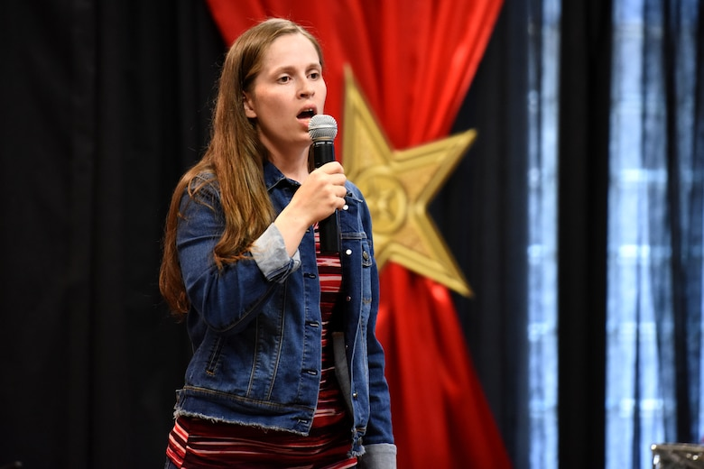 Goodfellow's Got Talent Show participant, Sariah Berglund sings 'America the Beautiful' during the competition at the Event Center on Goodfellow Air Force Base, Texas, June 8, 2018. Berglund placed second in the competition this year. (U.S. Air Force photo by Airman 1st Class Seraiah Hines/Released)