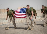 UNDISCLOSED LOCATON, MIDDLE EAST – U.S. Marines with Special Purpose Marine Air-Ground Task Force, Crisis Response-Central Command carry the American flag during A Ruck to Remember 10k Hike June 9, 2018. The hike honored fallen servicemen and women.